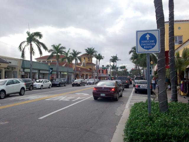 Delray Beach Streetscape: Note the drive lanes separated from pedestrians by a row of parked cars, a tree row, and canopies at most stores work together to create a comfortable pedestrian environment